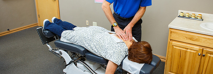 Chiropractor Green Bay WI Christopher Meyer Treating Back Pain